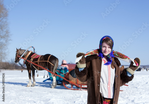 girl in russian traditional clothes and horse-drawn