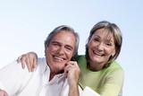 Fototapety Seniors couple making a phone call
