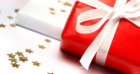Red and white colored gifts on white background