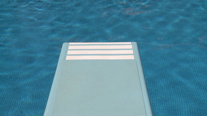 Swimming pool with diving board