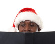 happy black santa claus reading a book
