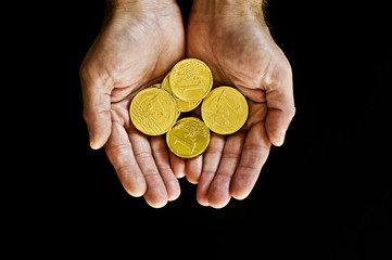 Gold coins in hand
