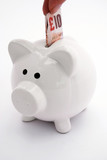 Piggy bank with ten pound note poster