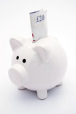 White piggy bank with twenty pound note poster