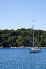 Sailing Yacht in Blue Bay