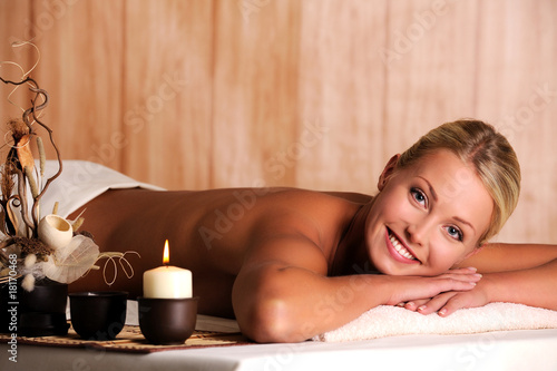 smiling young woman  relaxation in spa salon