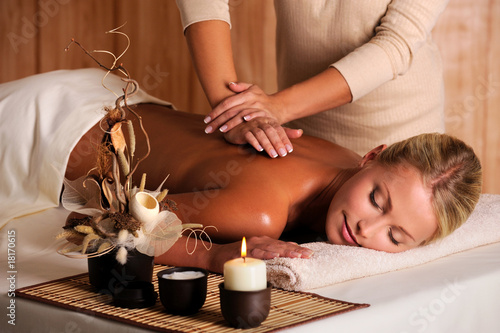 professional masseur doing massage of female back