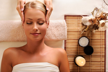 attractive female getting recreation massage of head
