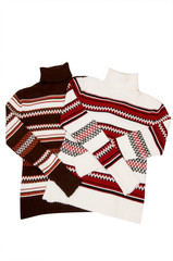 Winter comfortable sweaters on a white.