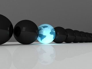 black balls with one blue planet