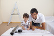 Father and son drawing architectural plans