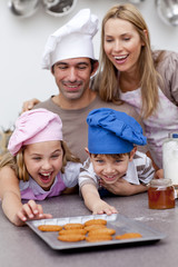 Children and parents eating cookies after baking