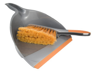 silver and orange dust pan and brush on white