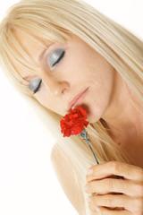 blonde enjoying flower