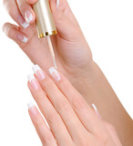 female hands  applying nail vanish on fingernail poster