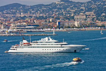 Large White Yacht and Yellow Lifeboat