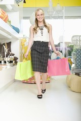 female shopper walks with shopping bags