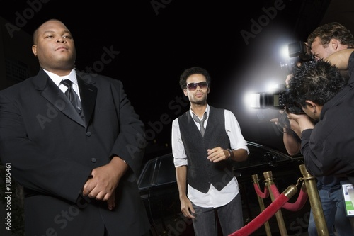 Male celebrity arriving at media event