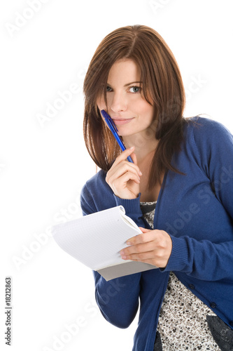 Young woman doing records by pen in notepad