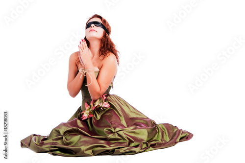 Young beautiful girl in dress who pray
