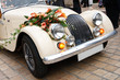 Vintage Wedding Car Decorated with Flowers - 18219475