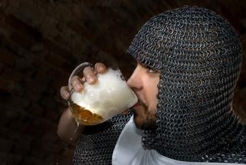 Knight drinking bear
