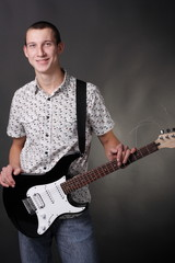 Teenager holding the guitar