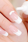 cosmetic  moisturizing cream on female fingernail poster