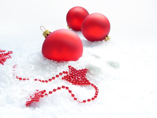 three red balls and stars in the snow