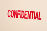 Red confidential stamp on a folder poster