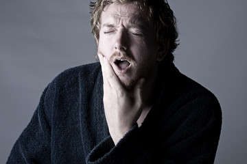 Man in Pain holding his Jaw. Toothache!