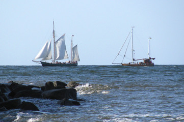 two sailing ships on the water