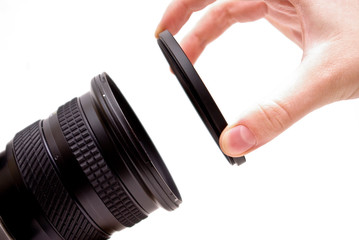 A filter being put on a camera lens.