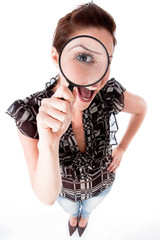 young woman looking up with a magnifying glass