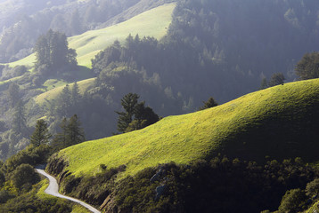 Winding country road and rolling green hills