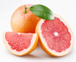 Grapefruits and segments with a leaf on a white background