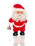 Santa Claus figurine holding bell, isolated on white