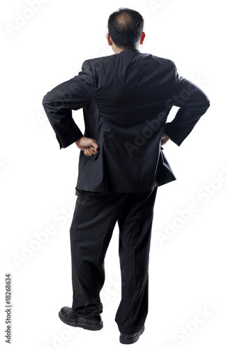 Balding man in Suit Arms Akimbo