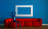 Person relaxing on the red sofa with empty frame in blue minimal poster