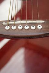 acoustic guitar bridge and strings.