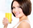 beautiful woman holding glass of orange juice