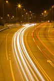 Long exposure of urban night traffic, focus on the road poster
