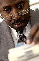 Businessman looking on rolodex