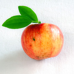 Apple with green leaves