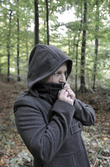 Woman wearing hooded coat