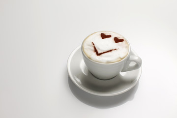 Cappuccino with face in milk
