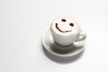 Cappuccino with face in froth