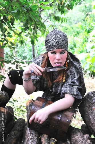 pirate girl is licking knife