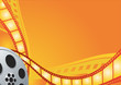 Film reel on the orange background