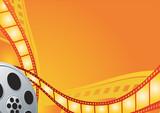Film reel on the orange background